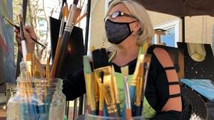 JoAnne Simon enjoying her newfound talent, painting. (Dave Charbonneau / CTV News Ottawa)