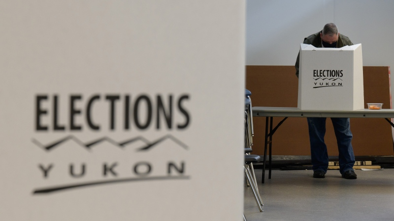 A voter is shown at a Whitehorse polling station during the Yukon election on Monday April 12, 2021. (THE CANADIAN PRESS / Mark Kelly)