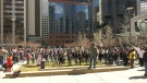 People gathered for a Stand Up for Small Business rally, hosted by Calgary Freedom Central, on Sunday.