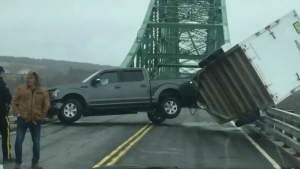 Andre and Gayle Bourgeois were on their way to Sydney to pick up furniture when the empty trailer on the back of their pickup truck jack-knifed in high winds and nearly plummeted more than 80 feet into the water below.