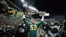 Edmonton Eskimos' Ryan King is surrounded by photographers as he hoists the Grey Cup trophy after defeating the Ottawa Redblacks to win the 103rd Grey Cup in Winnipeg, Man., Sunday, Nov. 29, 2015. THE CANADIAN PRESS/Darryl Dyck