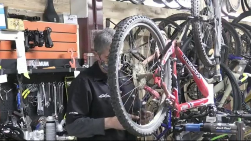 The owner of a Moncton bike shop says a major construction project to replace a causeway with a bridge has prompted many people to find a new way to commute.