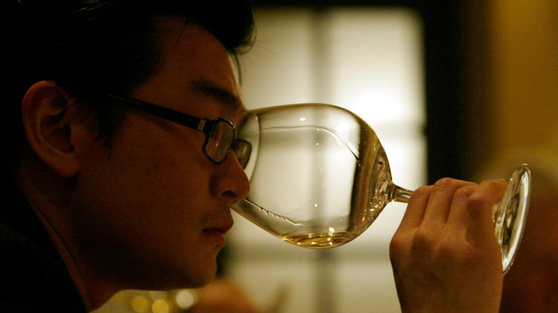 In this March 2, 2005 file photo, wine collector Rudy Kurniawan participates in a wine tasting in Los Angeles. (Ricardo DeAratanha/Los Angeles Times via AP, File)
