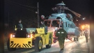 The helicopter was towed along Cow Bay Road and Main Road back to the base in Shearwater. (CTV ATLANTIC / JIM KVAMMEN)