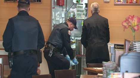 Police investigate the scene of a murder in the Annex which occurred at a popular sushi restaurant on Saturday, Nov. 8, 2009.