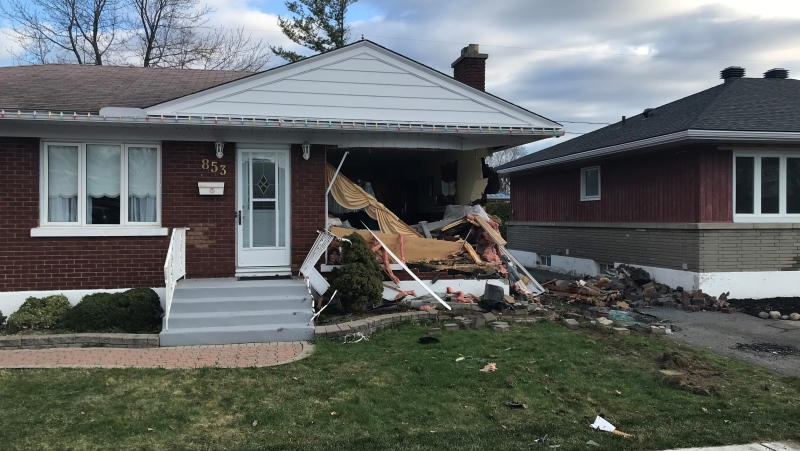 Ottawa police say a driver was pronounced dead at the scene after their vehicle rolled and crashed into this house on Chapman Blvd. No one inside the home was hurt. (Jim O'Grady / CTV News Ottawa)