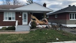 Ottawa police say a driver was pronounced dead at the scene after their vehicle rolled and crashed into this house on Chapman Blvd. No one inside the home was hurt. (Jim O'Grady / CTV News Ottawa) **NOTE: Image edited to remove street address.