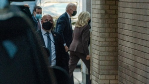U.S. President Joe Biden accompanies first lady Jill Biden to an appointment for a 'common medical procedure' at an outpatient centre in Washington, on April 14, 2021. (Andrew Harnik / AP)
