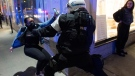 Police try and detain a woman as anti-curfew protests continue for a second night Monday, April 12, 2021 in Montreal. THE CANADIAN PRESS/Ryan Remiorz