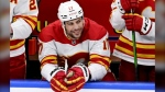 Calgary Flames' Milan Lucic (17) smiles on the bench as he is recognized for playing in his 1,000th NHL game during first period NHL hockey action against the Toronto Maple Leafs in Toronto on Tuesday, April 13, 2021. (Frank Gunn/The Canadian Press)