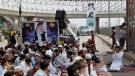 Supporters of Tehreek-e-Labiak Pakistan, a radical Islamist political party, pray while blocking a road during a sit-in protest against the arrest of their party leader Saad Rizvi, in Lahore, Pakistan, on April 14, 2021. (K.M. Chaudary / AP)