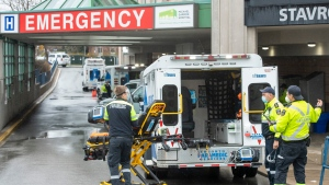 Paramedics and ambulances spill out of the Emergency ramp at Michael Garron Hospital in Toronto on Monday, April 12, 2021. THE CANADIAN PRESS/Frank Gunn