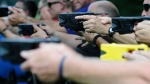 Fatal mix-ups involving Tasers and guns are very rare. Law enforcement and park rangers are shown using a variety of Tasers during training in 2014. (Curt Habraken/The Mountain Press/AP)
