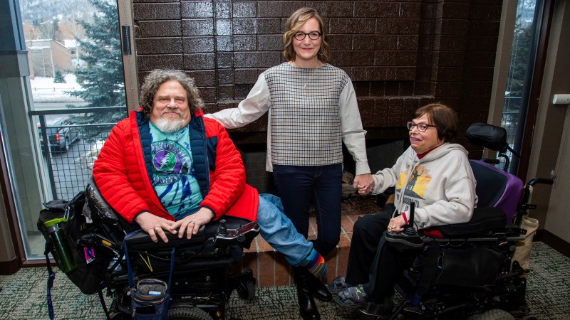"In this Jan. 24, 2020 file photo, co-directors Jim LeBrecht, left, and Nicole Newnham, center, from the documentary ""Crip Camp"" pose with film subject Judith Heumann during the Sundance Film Festival in Park City, Utah. The disabled have a moment in the Oscar spotlight that they hope becomes a movement. LeBrecht, who has spina bifida and uses a wheelchair, says a golden age for disabled films could come if Hollywood lets them tell their own stories. (Photo by Charles Sykes/Invision/AP, File)"