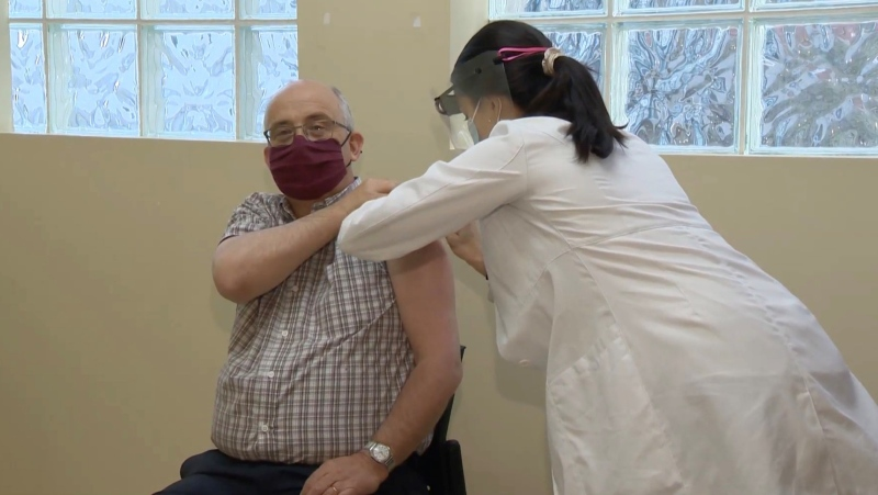 Gary Burrill received his first shot of the Pfizer vaccine on Wednesday in Halifax. (Cory McGraw/ CTV News)