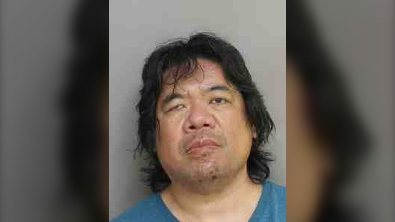 Toronto resident Jonathan Wong, 50, has been charged with voyeurism following an investigation. (Toronto Police Service)
