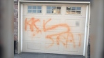 """Calgary police say a Royal Oak home was tagged with what they say is """"hate-motivated"""" graffiti. (Supplied)"""