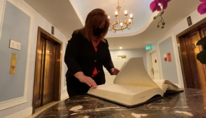 Deneen Perrin, marketing and media director with the Fairmont Chateau Laurier, flips through a guestbook, looking back at celebrities and world leaders she has met throughout her 25 year career. (Tyler Fleming/CTV News Ottawa)