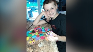Jaxon Steffler and the keychains he's making as a fundraiser