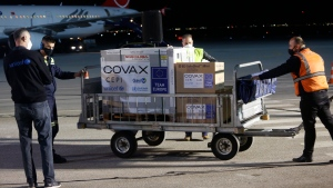 Airport personal unload the first batch of the AstraZeneca vaccines sent from the COVAX facility on Sunday, March 28, 2021, at Adem Jashari airport Pristina, Kosovo which is the last country in the continent yet to start the inoculation. Authorities said they got 24,000 slabs through the COVAX system which will be used for the medical personnel, eldest people, and those with chronic diseases. (AP Photo)