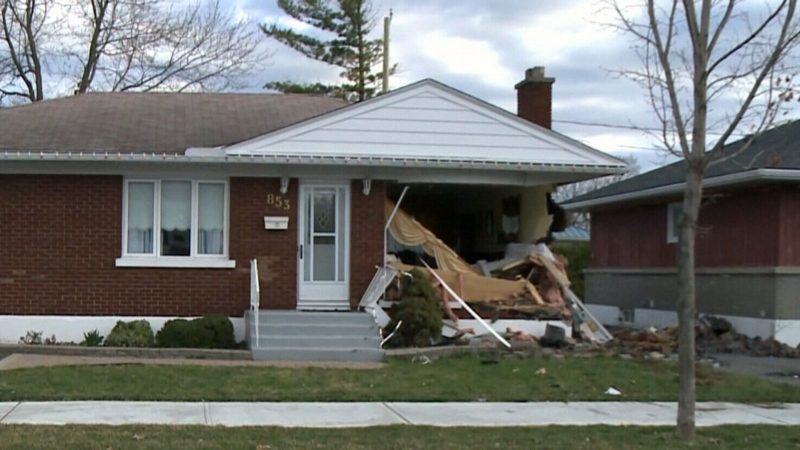 Driver dead after car slams into home