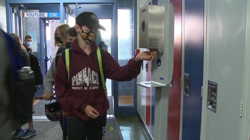 Student hand sanitizing