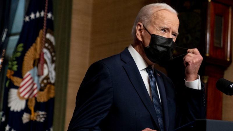 U.S. President Joe Biden removes his mask to speak from the Treaty Room in the White House on Wednesday, April 14, 2021, about the withdrawal of the remainder of U.S. troops from Afghanistan. (AP Photo/Andrew Harnik, Pool)