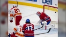 Calgary Flames' Josh Leivo (27) scores the third goal against Montreal Canadiens goaltender Jake Allen (34) during third period NHL hockey action Wednesday, April 14, 2021 in Montreal. THE CANADIAN PRESS/Ryan Remiorz