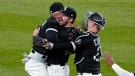 Chicago White Sox starting pitcher Carlos Rodon, center, celebrates his no-hitter against the Cleveland Indians with his teammates in a baseball game, Wednesday, April, 14, 2021, in Chicago. (AP Photo/David Banks)