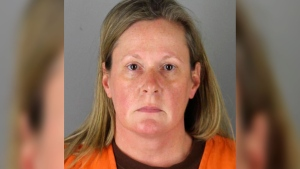 This booking photo released by the Hennepin County, Minn., Sheriff shows Kim Potter, a former Brooklyn Center, Minn., police officer who is charged Wednesday, April 14, 2021, with second-degree manslaughter for killing 20-year-old Black motorist Daunte Wright in a shooting that ignited days of unrest and clashes between protesters and police. (Hennepin County Sheriff via AP)