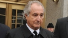 Bernard Madoff exits Manhattan federal court, Tuesday, March 10, 2009, in New York. Madoff, the financier who pleaded guilty to orchestrating the largest Ponzi scheme in history, died early Wednesday, April 14, 2021, in a federal prison, a person familiar with the matter told The Associated Press. (AP / Louis Lanzano, File)
