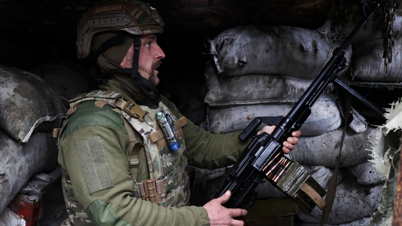 A Ukrainian soldier is seen at fighting positions on the line of separation from pro-Russian rebels near Donetsk, Ukraine, Wednesday, April 14, 2021. (AP Photo)