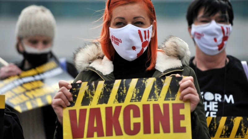 People march demanding the resignation of the government over the poor handling of the coronavirus pandemic in Sarajevo, Bosnia, on April 6, 2021. (Kemal Softic / AP)