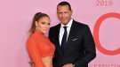 Jennifer Lopez and Alex Rodriguez say they are better off as friends. The stars announced on April 15 that they are officially ending their two-year engagement. (Angela Weiss/AFP/Getty Images)