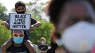 FILE - In this June 4, 2020, file photo, demonstrators gather to protest for George Floyd during a Black Lives Matter protest at the Buffalo Grove park District's Spray 'N Play in Buffalo Grove, Ill. (Nam Y. Huh / AP)