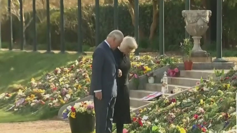 Prince Charles views tributes of his father