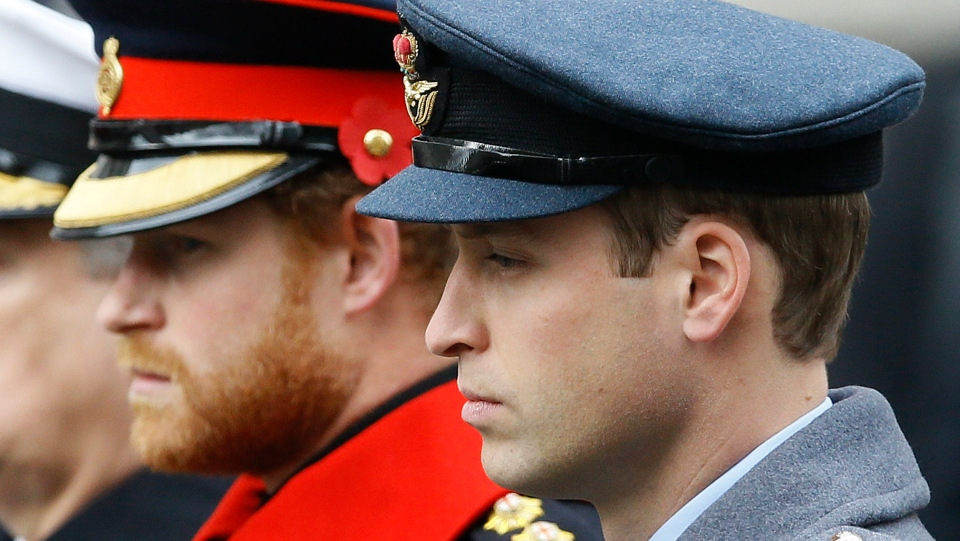 In this Sunday Nov. 8, 2015 file photo, Prince William, right, and Prince Harry attend the Remembrance Sunday ceremony at the Cenotaph in London. Senior royals must wear civilian clothes to Prince Philip's funeral, defusing potential tensions over who would be allowed to don military uniforms. Queen Elizabeth II's decision means Prince Harry won't risk being the only member of the royal family not in uniform during the funeral on Saturday April 17, 2021 for his grandfather, who died last week at the age of 99. (AP Photo/Kirsty Wigglesworth, File)