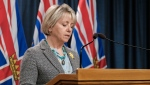 Health Minister Adrian Dix and Chief Provincial Health Officer Dr. Bonnie Henry provide an update on COVID-19 on April 12, 2021. (Province of BC/Flickr)