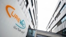 "The logo of the biotech company Curevac with slogan ""the RNA people"" is displayed at the company headquarters in Tuebingen, Germany, Thursday, Jan. 7, 2021. (Sebastian Gollnow/dpa via AP)"