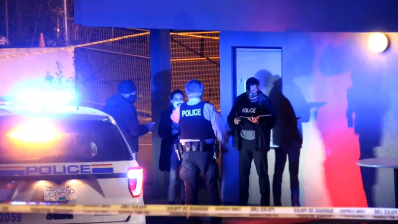 Police are seen at the Grouse Motel in Surrey on Thursday, April 15, 2021.
