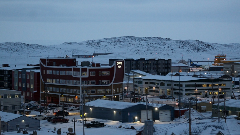 Downtown Iqaluit, Nunavut, is shown after 2 p.m. sunset on Tuesday, Nov. 24, 2020. Iqaluit, like the rest of Nunavut, is under a strict two-week lockdown to help stop the spread of COVID-19. THE CANADIAN PRESS/Emma Tranter