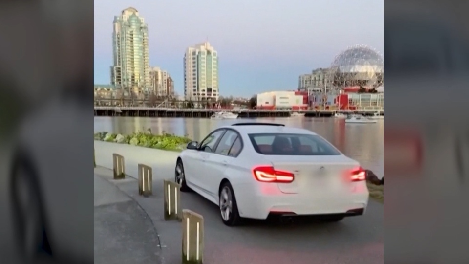 A driver was spotted in a BMW on the False Creek seawall in the evening of April 14, 2021.