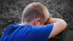 An upset child is seen in this stock image. (Pexels)