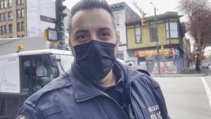 Const. Deepak Sood of the Vancouver Police Department seen in a video recorded by overdose prevention advocate Sarah Blyth outside a safe consumption site in the Downtown Eastside.