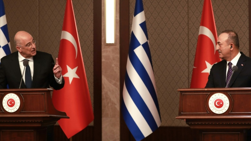 Talks between Foreign Minister Mevlut Cavusoglu (R) and his Greek counterpart Nikos Dendias included a heated news conference. (AFP)