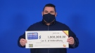 Lee Evans, 47, of Amherstburg won $1 million by saying yes to Encore. (courtesy OLG)