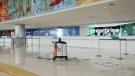 Robot cleaning inside San Antonio airport (Bryan Glazer/World Satellite Television News via AP Images)