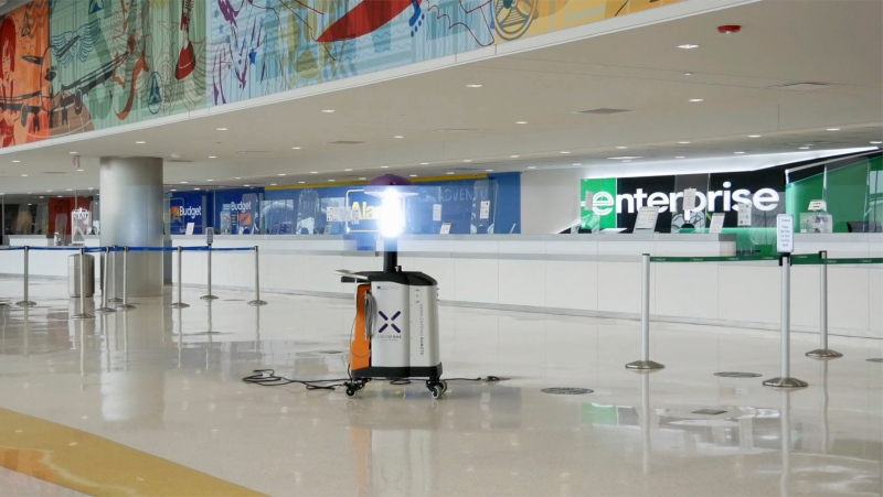 Robot cleaning inside San Antonio airport  (Bryan Glazer/World Satellite Television News via AP Images)