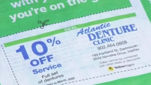 While the shooter's name doesn't appear in the book, his former business, Atlantic Denture Clinic, is advertised on a coupon offering a 10 per cent discount for dentures.