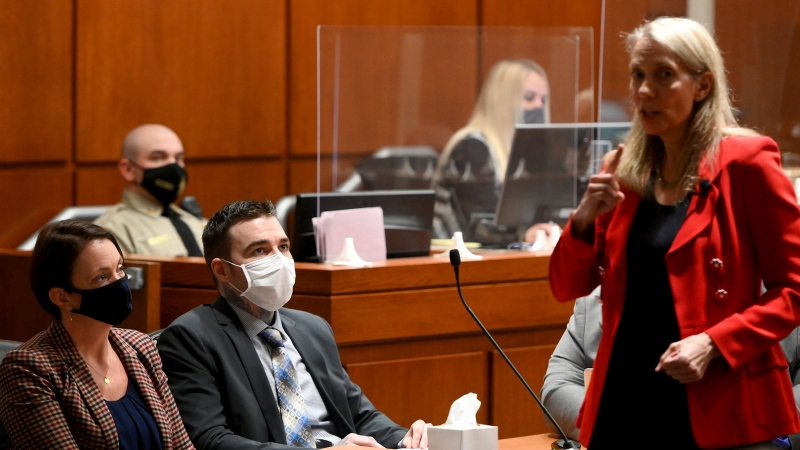 Kylr Yust and his attorney Molly Hastings, left, listen to the opening statement of defense attorney Sharon Turlington, Monday, April 5, 2021 in Harrisonville, Mo. Prosecutors began to make their case that the man killed two Kansas City-area women nearly a decade apart. Selection of a jury for the trial of Kylr Yust was completed Wednesday in St. Charles County. (Jill Toyoshiba/The Kansas City Star via AP, Pool)